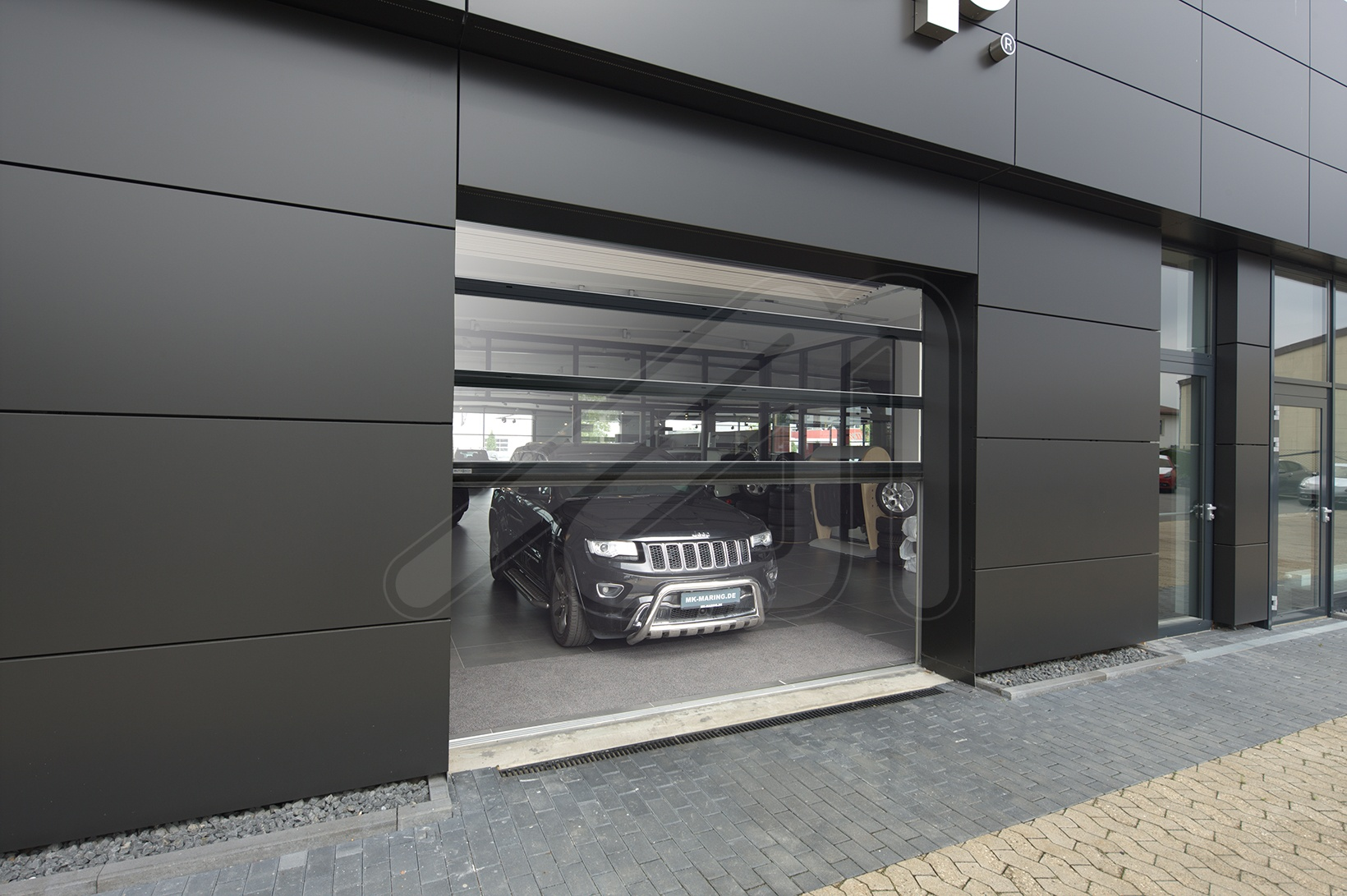 Two models of sectional doors for the automotive sector